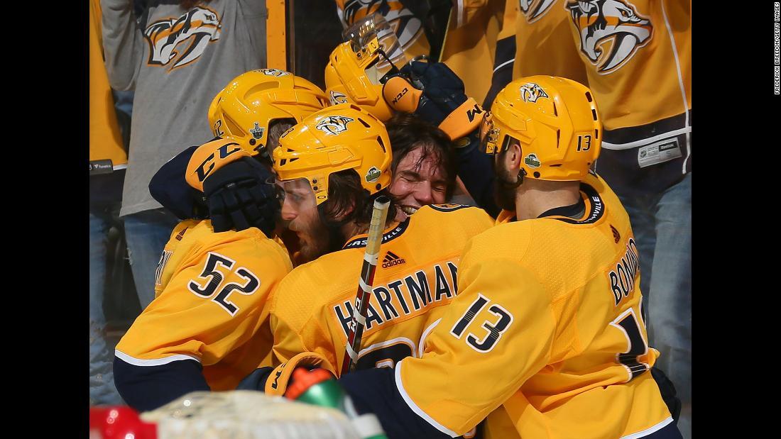 "Kevin Fiala is swarmed by his Nashville teammates after scoring <a href=""https://www.instagram.com/p/BiLfduOFxeK"" target=""_blank"">the game-winning goal</a> in double overtime on Sunday, April 29. The Predators defeated Winnipeg 5-4 to tie their second-round playoff series at one game apiece."