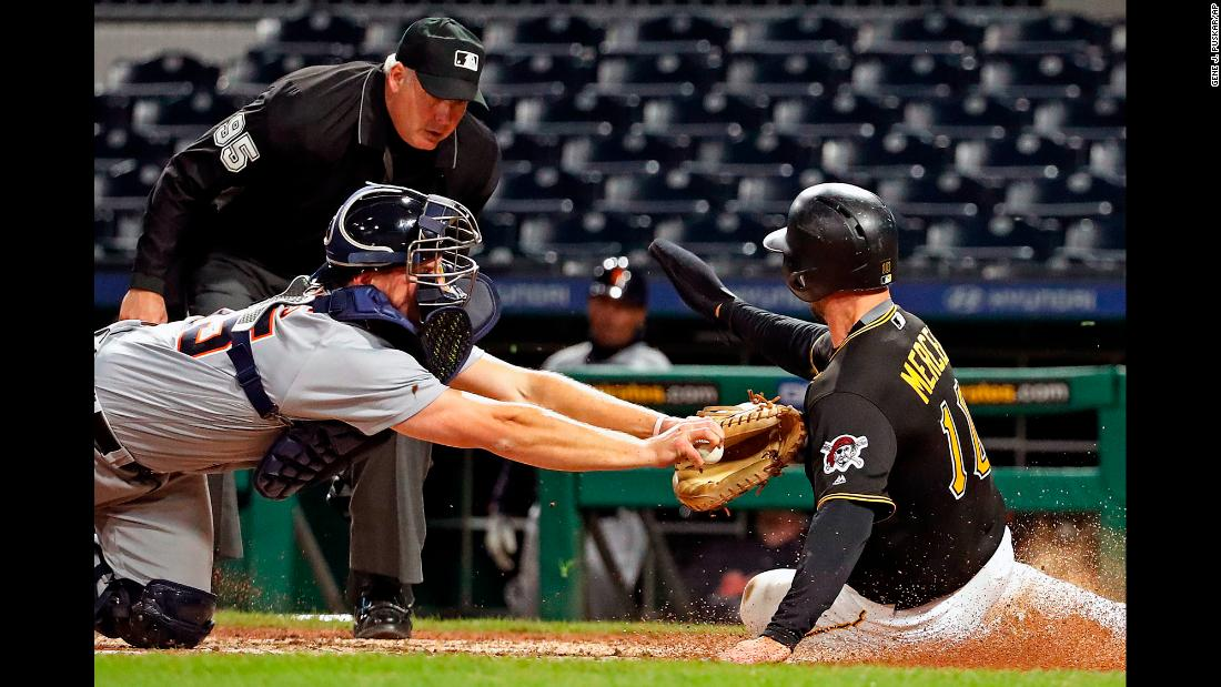 Pittsburgh's Jordy Mercer slides into home, avoiding the tag by Detroit's John Hicks on Wednesday, April 25. Pittsburgh won 8-3 in what was the second game of a doubleheader. Detroit won the first game 13-10.