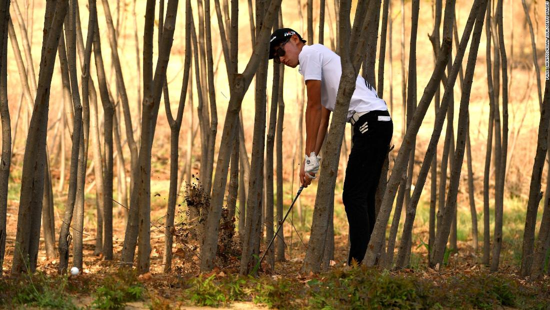 Micah Shin hits out of the trees during the second round of the China Open on Friday, April 27.