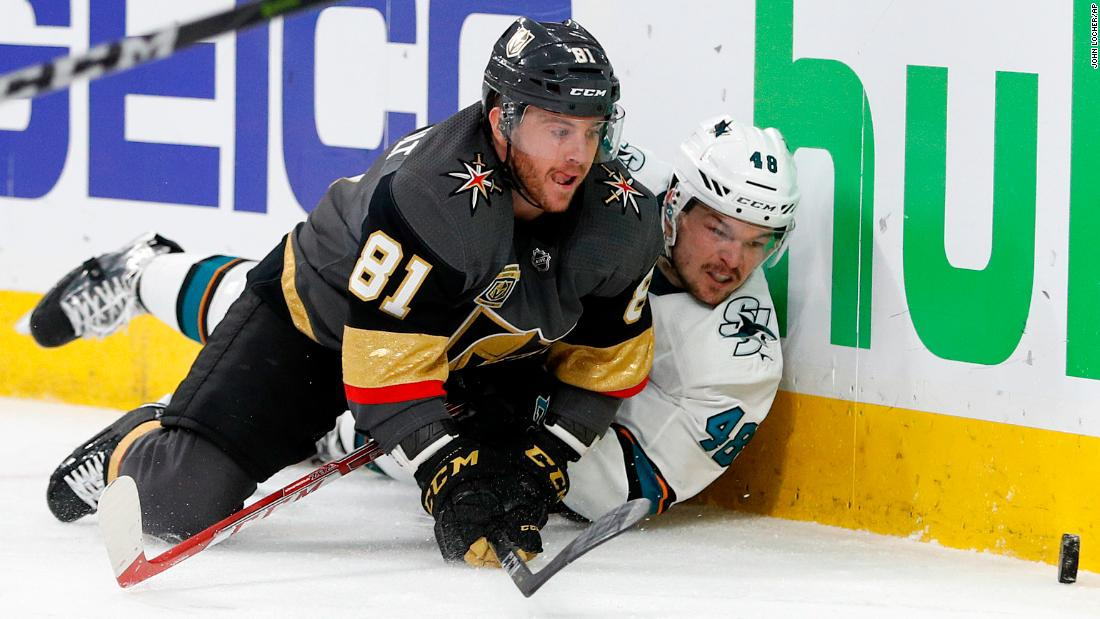 Vegas' Jonathan Marchessault, left, and San Jose's Tomas Hertl eye the puck during an NHL playoff game on Saturday, April 28.