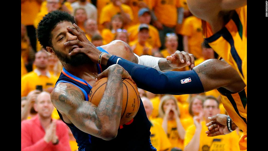 Oklahoma City forward Paul George is fouled by Utah's Jae Crowder during Game 6 of their first-round playoff series on Friday, April 27.