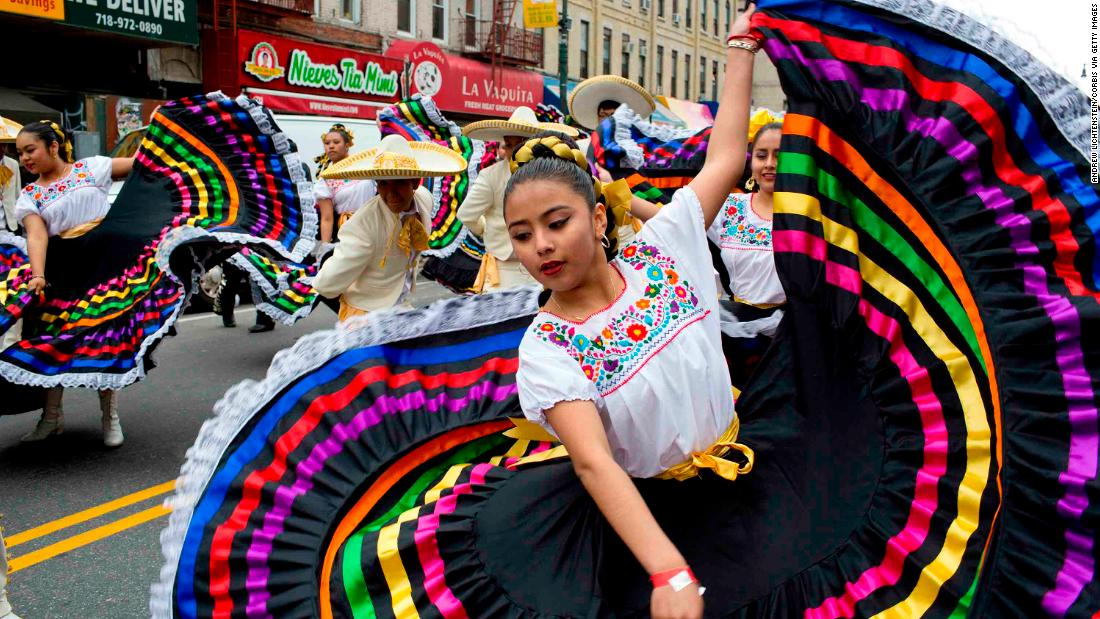 BROOKLYN, NY - MAY 7: Brooklyn's Mexican community marches down 5th Avenue in the Sunset Park neighborhood during a Cinco de Mayo parade on May 7, 2017 in Brooklyn, New York. The holiday, which commemorates a Mexican military victory over the French, has taken on an importance in the Mexican American communities across the United States that it does not have in Mexico itself. (Photo by Andrew Lichtenstein/Corbis via Getty Images)