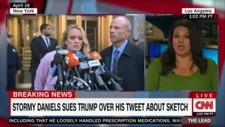 Lead Sara Sidner reports Stormy sues Trump live Jake Tapper_00005906.jpg