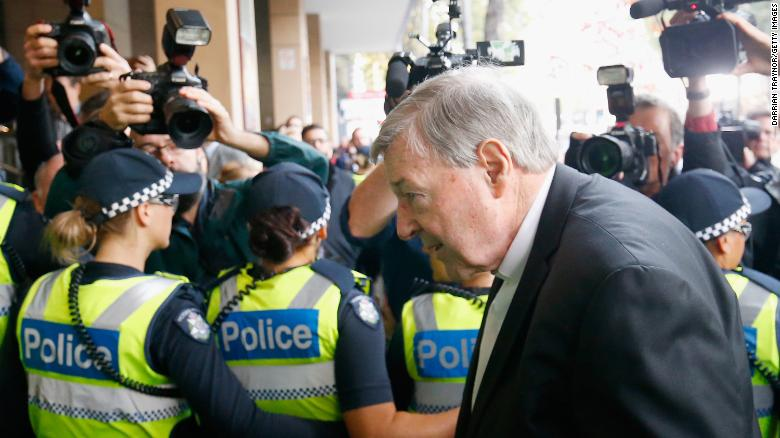 Police cordon off the media as Cardinal Pell walks into Melbourne Magistrates' Court on May 1, 2018.
