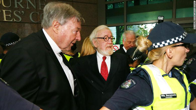 Cardinal George Pell (L) arrives with his lawyer at Melbourne Magistrates' Court on May 1 in Melbourne, Australia.
