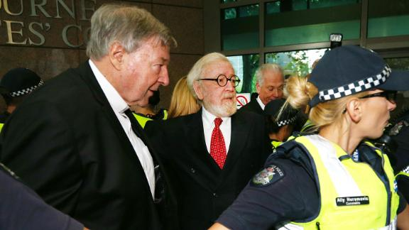 MELBOURNE, AUSTRALIA - MAY 01:  Cardinal George Pell (L) arrives with his defending lawyer Robert Richter QC at Melbourne Magistrates