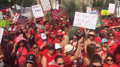 Arizona's public school teachers and their supporters marched on the state Capitol in Phoenix Monday, the third day of the state's first ever teacher walk out.