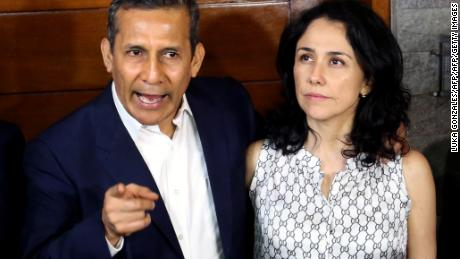 Peru's former President (2011-2016) Ollanta Humala speaks next to his wife Nadine Heredia outside their home after being released from preventative detention awaiting trial on charges of money laundering, in Lima on April 30, 2018. - Humala and Heredia, who allegedly received millions of dollars in illegal campaign donations from Brazilian construction giant Odebrecht ahead of the 2011 election, had been in prison since July 2017. (Photo by Luka GONZALES / AFP)        (Photo credit should read LUKA GONZALES/AFP/Getty Images)