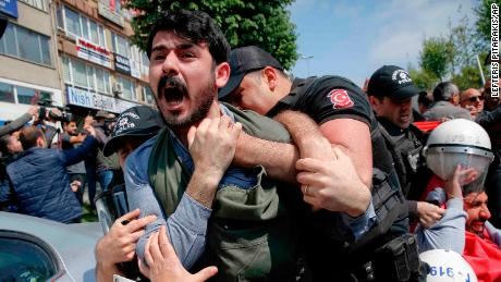 A demonstrator screams as police officers grab him, during May Day protests in Istanbul, Turkey, Tuesday, May 1, 2018. Police detained several demonstrators as the crowd tried to march toward Istanbul's Taksim Square, which is symbolic as the center of protests in which dozens of people were killed in 1977.(AP Photo/Lefteris Pitarakis)