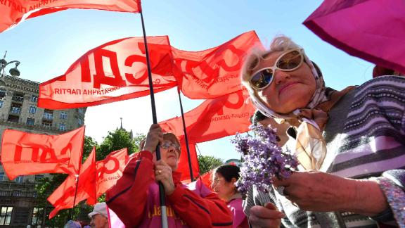 Trade unionists wave flags during a march in Kiev.