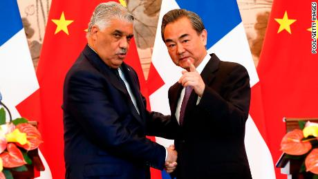 China's Foreign Minister Wang Yi shakes hands with Dominican Republic's Chancellor Miguel Vargas during a signing ceremony on May 1  in Beijing, China.