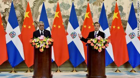 China's Foreign Minister Wang Yi, right, speaks after a signing ceremony with Dominican Republic Foreign Minister Miguel Vargas, left, after they  formally established relations.