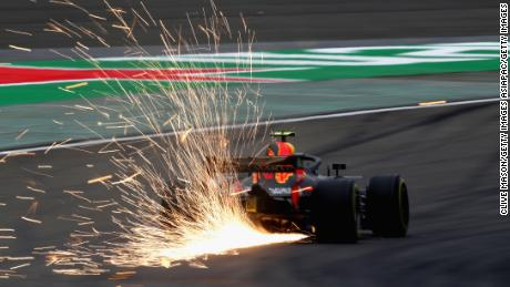SHANGHAI, CHINA - APRIL 13: Sparks fly behind Max Verstappen of the Netherlands driving the (33) Aston Martin Red Bull Racing RB14 TAG Heuer on track during practice for the Formula One Grand Prix of China at Shanghai International Circuit on April 13, 2018 in Shanghai, China.  (Photo by Clive Mason/Getty Images)