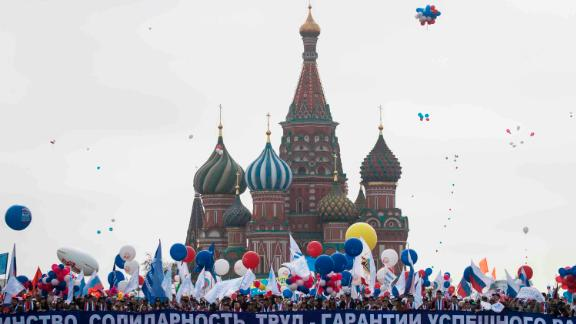 Balloons fly above a rally in Red Square, Moscow.
