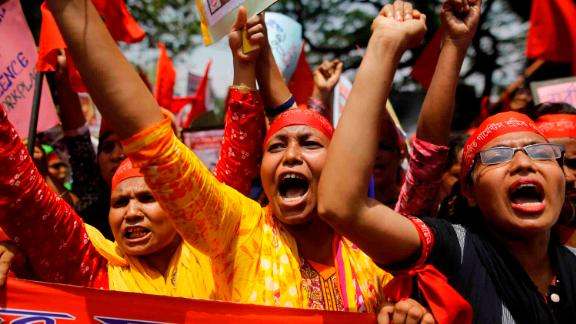 Garment workers attend a rally in the capital Dhaka. In 2013, more than 1,000 people died when a garment factory collapsed in the same city.