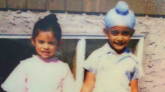 Winty Singh, with his sister Trishanjit as children, says he was bullied over his religion in school.