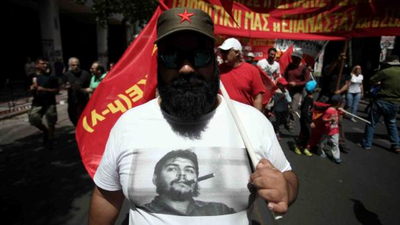 A demonstrator marches in Athens. A number of trade unions marked May Day with a 24-hour nationwide strike.