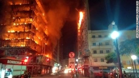 Photos showing a building on fire in Sao Paulo