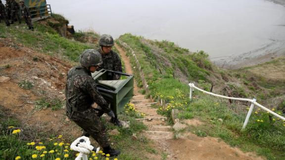 South Korean soldiers take down a propaganda loudspeakers on Tuesday.