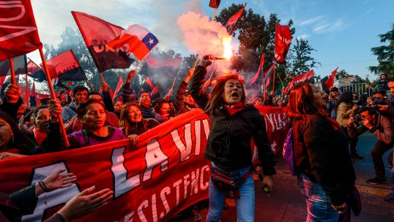 Chilean workers take part in a May Day march in the capital of Santiago.