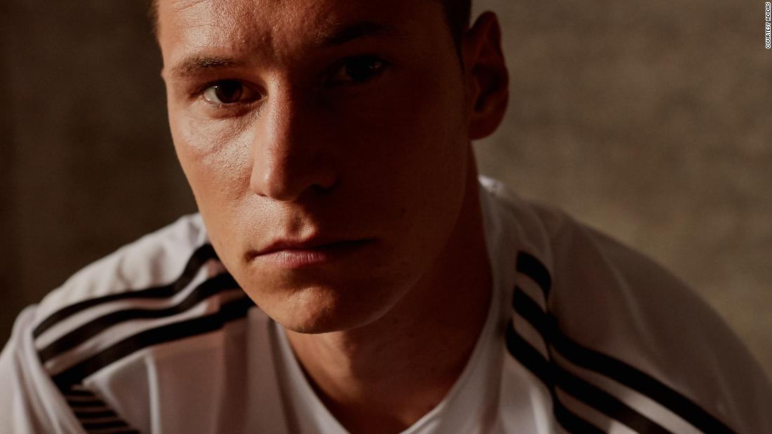 For Germany, Adidas looked to the past. The horizontal graphic printed across the chest recalls the uniform won by the German team that won the 1990 World Cup team. The gold crest symbolizes the defending champs' victory in 2014.