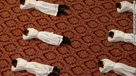 Newly ordained priests lie on the floor as Pope Francis leads a mass in Saint Peter's Basilica at the Vatican / AFP PHOTO / POOL / TONY GENTILETONY GENTILE/AFP/Getty Images