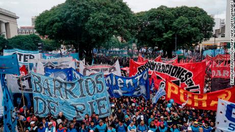 Members of leftist organizations take part in a May Day march in Buenos Aires, on May 1, 2018. (Photo by EITAN ABRAMOVICH / AFP)        (Photo credit should read EITAN ABRAMOVICH/AFP/Getty Images)