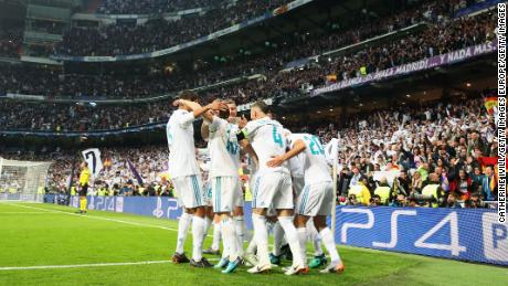 MADRID, SPAIN - MAY 01:  Karim Benzema of Real Madrid (obscured) celebrates as he scores his sides second goal with team mates during the UEFA Champions League Semi Final Second Leg match between Real Madrid and Bayern Muenchen at the Bernabeu on May 1, 2018 in Madrid, Spain.  (Photo by Catherine Ivill/Getty Images)