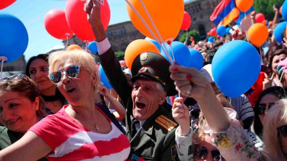 Supporters of the opposition lawmaker Nikol Pashinian shout slogans during a rally at the Republic square in Yerevan on Tuesday, May 1, 2018. Pashinian, who sparked two weeks of protests that threw Armenia into a political crisis, so far is the only candidate formally nominated for the prime minister's post. (AP Photo/Thanassis Stavrakis)