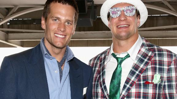 Famous faces regularly flock to Churchill Downs for the Derby. Here, NFL stars Tom Brady and Rob Gronkowski soak up the atmosphere in 2015. A horse named after New England Patriot's tight end Gronkowski was due to run in this year's race, but had to pull out with a fever.