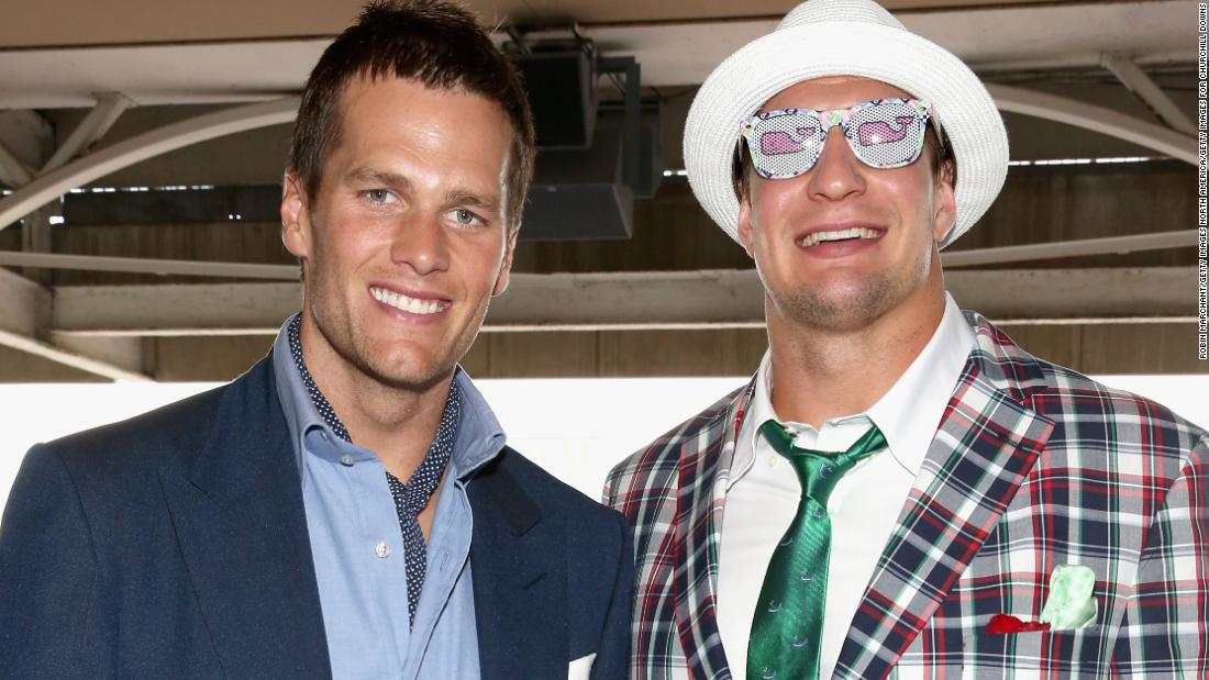 "Famous faces regularly flock to Churchill Downs for the Derby. Here, NFL stars Tom Brady and Rob Gronkowski soak up the atmosphere in 2015. A horse named after New England Patriot's tight end Gronkowski was due to run in this year's race, but <a href=""https://edition.cnn.com/2018/04/24/sport/kentucky-derby-gronkowski-horse-racing-nfl-spt/index.html"">had to pull out with a fever</a>."
