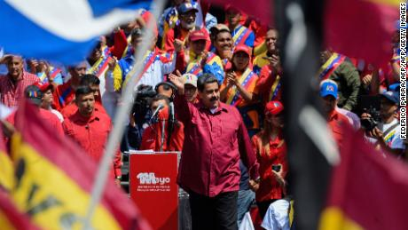 Venezuelan President Nicolas Maduro waves during a May Day rally in Caracas, on May 1, 2018. (Photo by Federico PARRA / AFP)        (Photo credit should read FEDERICO PARRA/AFP/Getty Images)