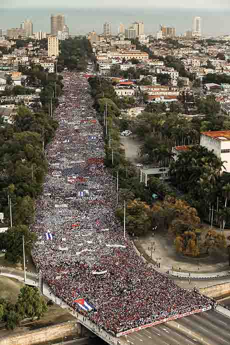 People march to Revolution Square in Havana, Cuba, during the annual May Day parade.