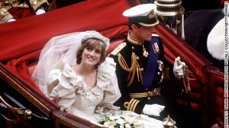 Prince Charles and Diana, who wears the Spencer family tiara, return to Buckingham Palace by carriage after their wedding in July 1981.
