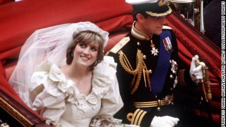 The Prince and Princess of Wales return to Buckingham Palace by carriage after their wedding, 29th July 1981. She wears a wedding dress by David and Elizabeth Emmanuel and the Spencer family tiara. (Photo by Princess Diana Archive/Getty Images)