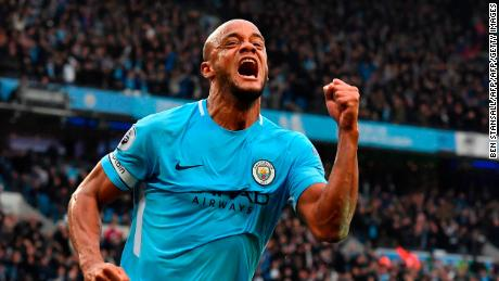 TOPSHOT - Manchester City's Belgian defender Vincent Kompany celebrates scoring the opening goal during the English Premier League football match between Manchester City and Manchester United at the Etihad Stadium in Manchester, north west England, on April 7, 2018. / AFP PHOTO / Ben STANSALL / RESTRICTED TO EDITORIAL USE. No use with unauthorized audio, video, data, fixture lists, club/league logos or 'live' services. Online in-match use limited to 75 images, no video emulation. No use in betting, games or single club/league/player publications.  /         (Photo credit should read BEN STANSALL/AFP/Getty Images)