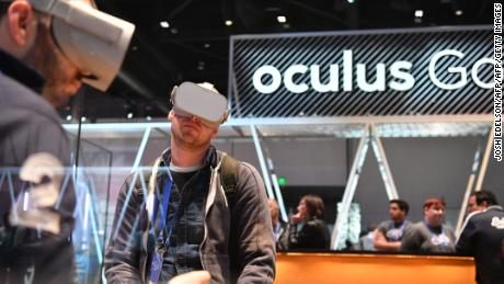 People try out the new Oculus Go during the annual F8 summit at the San Jose McEnery Convention Center in San Jose, California on May 1, 2018. - Facebook chief Mark Zuckerberg announced the world's largest social network will soon include a new dating feature -- while vowing to make privacy protection its top priority in the wake of the Cambridge Analytica scandal. (Photo by JOSH EDELSON / AFP)        (Photo credit should read JOSH EDELSON/AFP/Getty Images)