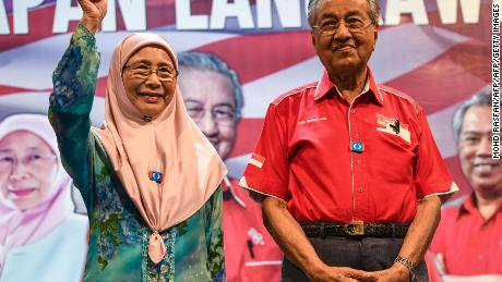 Wan Azizah, left, wife of jailed former opposition leader Anwar Ibrahim, gestures as former Malaysian Prime Minister Mahathir Mohamad, right, smiles during a rally ahead of the 14th general election in Malaysia's popular island of Langkawi.