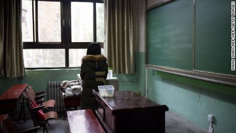 TOPSHOT - This picture taken on January 17, 2018 shows a female student in a classroom at Beihang University in Beijing.