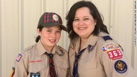 Ana and her mom pose for a photo after scout event.