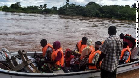 The Kenyan Red Cross uses a boat to evacuate people from their flooded village after the Tana River overflowed in coastal Kenya on April 27, 2018.