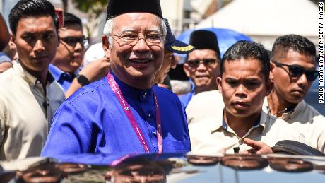 Malaysia's Prime Minister Najib Razak smiles as he leaves after submitting his documents at the nomination centre in Pekan on April 28.