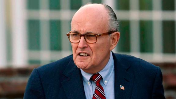 """FILE - In this Nov. 20, 2016 file photo, former New York Mayor Rudy Giuliani arrives at the Trump National Golf Club Bedminster clubhouse in Bedminster, N.J. President Donald Trump's new lawyer Rudy Giuliani said Wednesday, May 2, 2018, the president repaid attorney Michael Cohen for a $130,000 payment to porn star Stormy Daniels. Giuliani made the revelation during an appearance on Fox News Channel's """"Hannity."""" (AP Photo/Carolyn Kaster, File)"""