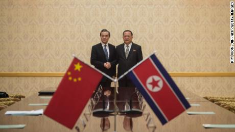 China's foreign minister Wang Yi (L) shakes hands with North Korea's foreign Minister Ri Yong Ho at the Mansudae Assembly Hall in Pyongyang on May 2, 2018. - China's foreign minister arrived in Pyongyang on May 2, the highest-ranking Chinese official to visit North Korea in years as Beijing tries to mend fences with its nuclear-armed neighbour. (Photo by KIM Won-Jin / AFP)        (Photo credit should read KIM WON-JIN/AFP/Getty Images)