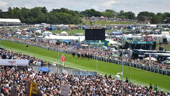 The Epsom racecourse for The Oaks and The Derby features a long climb out of the start, a sweeping left-hand turn around Tattenham Corner, a downhill straight and a stiff rise in the last few hundred yards.