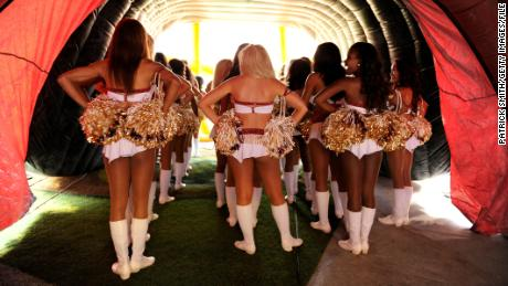 LANDOVER, MD - SEPTEMBER 09:  Washington Redskins cheerleaders wait in the tunnel before running out on the field against the Philadelphia Eagles at FedExField on September 9, 2013 in Landover, Maryland.  (Photo by Patrick Smith/Getty Images)