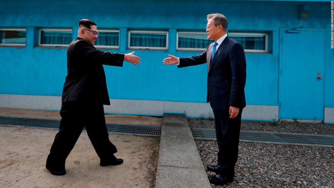 "North Korean leader Kim Jong Un, left, prepares to shake hands with South Korean President Moon Jae-in as they meet at the demarcation line that has separated their two countries for decades. Kim and Moon sat down for talks on Friday, April 27, and <a href=""https://www.cnn.com/interactive/2018/04/world/korea-summit-cnnphotos/"" target=""_blank"">their historic summit</a> ended with a declaration that the two countries -- who have been technically at war for almost 70 years now -- will sign a peace treaty later this year."