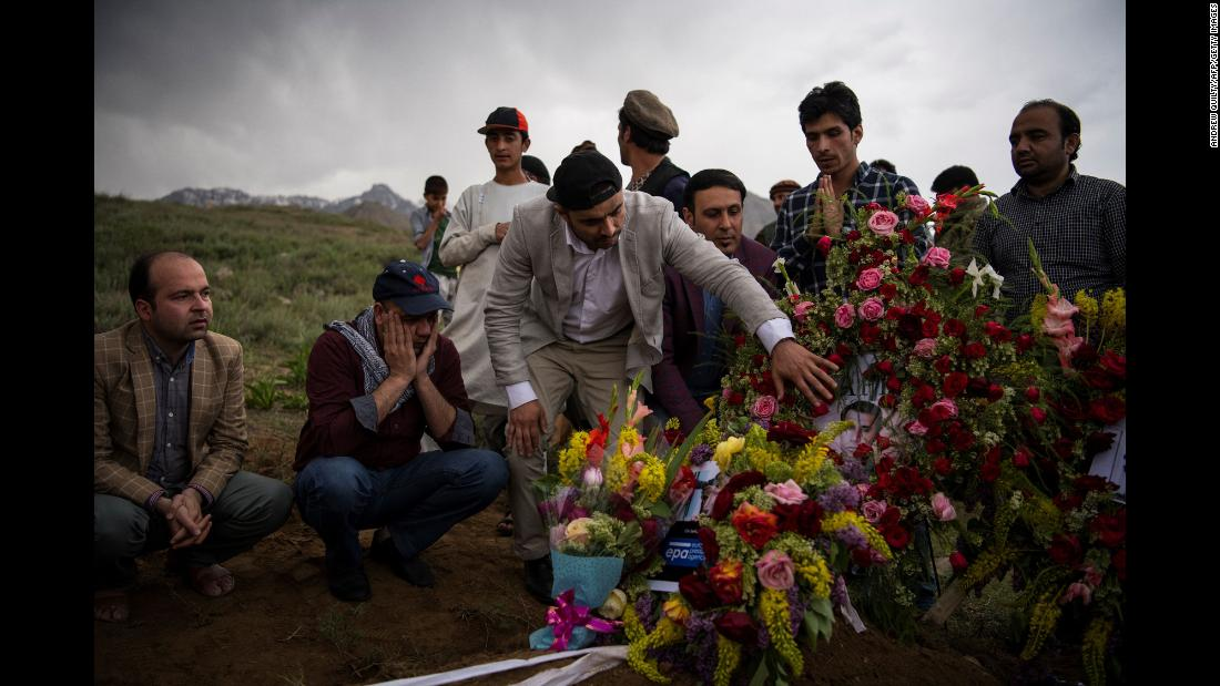 "Friends and relatives of photographer Shah Marai attend his burial in Kabul, Afghanistan, on Monday, April 30. Marai and nine other journalists were among the <a href=""https://www.cnn.com/2018/04/30/asia/afghanistan-kabul-blasts-intl/index.html"" target=""_blank"">31 people killed in a series of attacks</a> Monday in Afghanistan. ISIS claimed responsibility for the bombing that killed Marai, <a href=""https://www.cnn.com/2018/04/30/middleeast/afghan-photojournalist-shah-marai-intl/index.html"" target=""_blank"">an acclaimed photojournalist</a> who spent more than 15 years working in Afghanistan for Agence France-Presse."