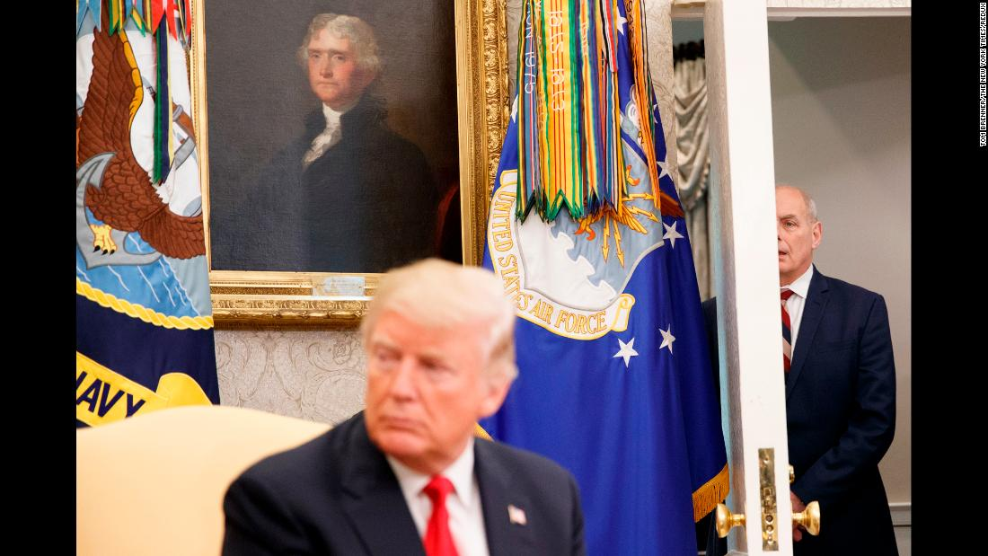 "White House Chief of Staff John Kelly watches from a doorway as US President Donald Trump meets with Nigerian President Muhammadu Buhari on Monday, April 30. <a href=""https://www.cnn.com/2018/04/30/politics/john-kelly-donald-trump-idiot/index.html"" target=""_blank"">Kelly denied an NBC report</a> that claimed he had called Trump an ""idiot"" during a meeting with aides. ""I spend more time with the President than anyone else and we have an incredibly candid and strong relationship. He always knows where I stand and he and I both know this story is total BS,"" Kelly said in a statement."