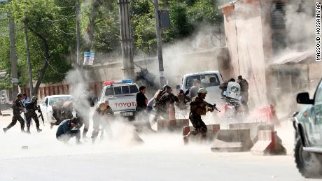 Security forces run from the site of second suicide attack in Kabul, Afghanistan,  on April 30.